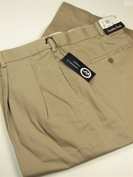 #012052. 40 38. KHAKI Retail $  69.00 Cotton Casual Pants by JONATHAN QUALE. PLEAT XPAND WRNKLFREE Whs A:  1